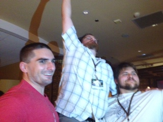 Brian McClellan, reveling in his moment of tallness, being held aloft by Justin Landon and Sam Sykes.
