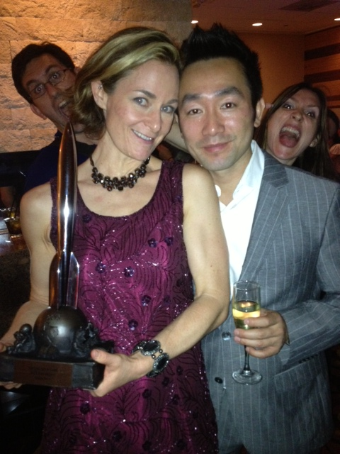 Here is Galen Dara and Wes Chu posing with her Hugo, and getting photobombed by Sandra Wickham and a gentleman I did not meet.